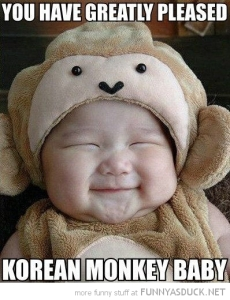 funny-happy-smiling-kid-baby-greatly-pleased-korean-monkey-baby-pics