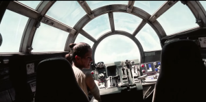 rey-piloting-the-millennium-falcon-alone